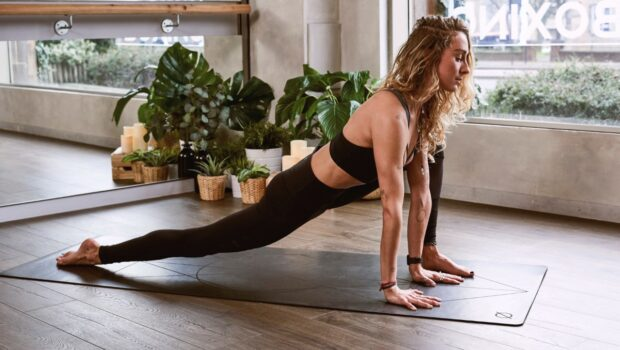 yoga-woman-stretching-legs-FGC